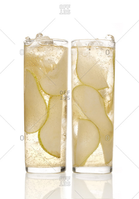 Tall cocktails with sliced pears