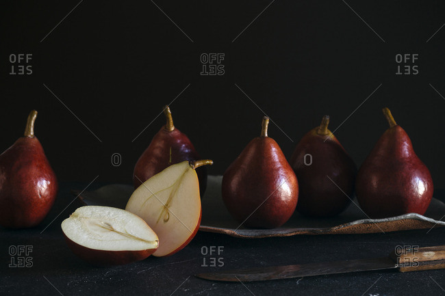 Still life of red pears on dark background