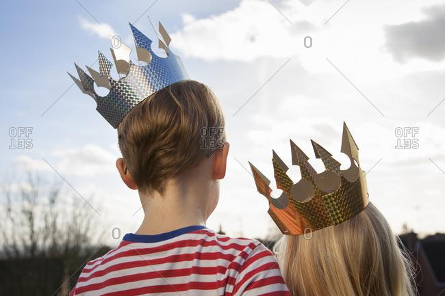 Two children in fancy dress, wearing crowns