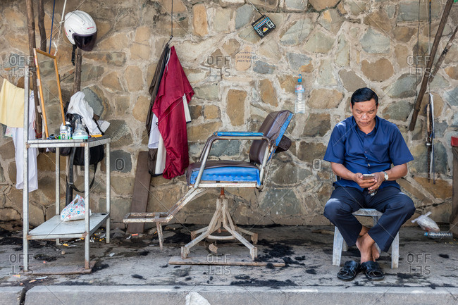 Cambodia - November 10, 2016: Barber with sidewalk business