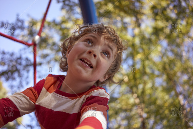 Curly haired boy in fall park setting