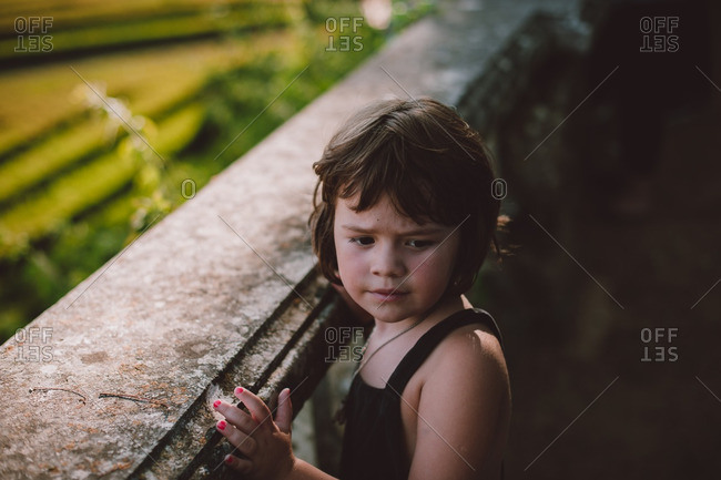 Little girl looking away confused