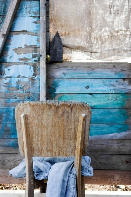 Denim jeans on a wood chair