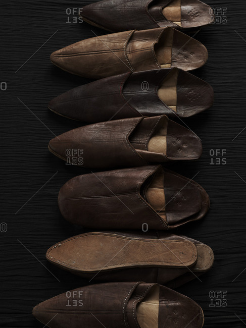 Line of leather slippers