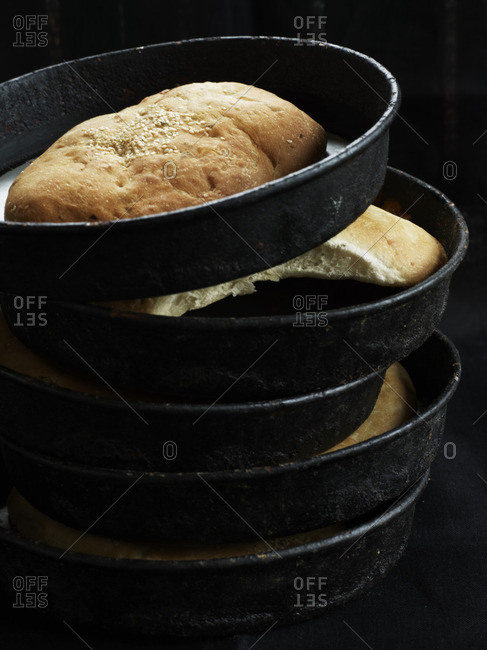 Stack of pie pans with bread