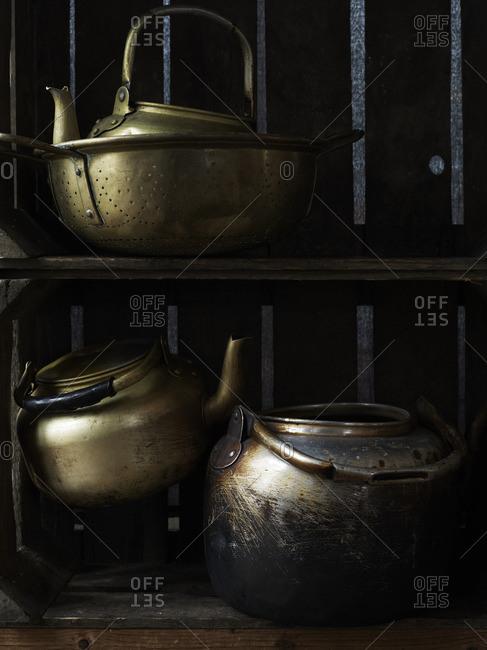 Tea kettles on window shelf