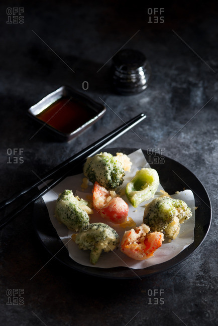 Plate of vegetable tempura with sauce