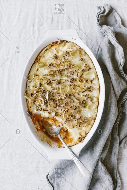 Double layered potato casserole with crispy leeks