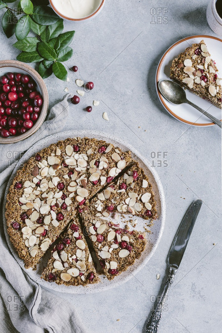 Sliced cranberry almond tart with cr�me fraiche and fresh cranberries
