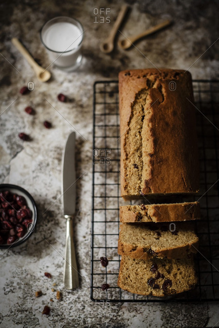 Sliced plum cake loaf with sweet dried cranberries