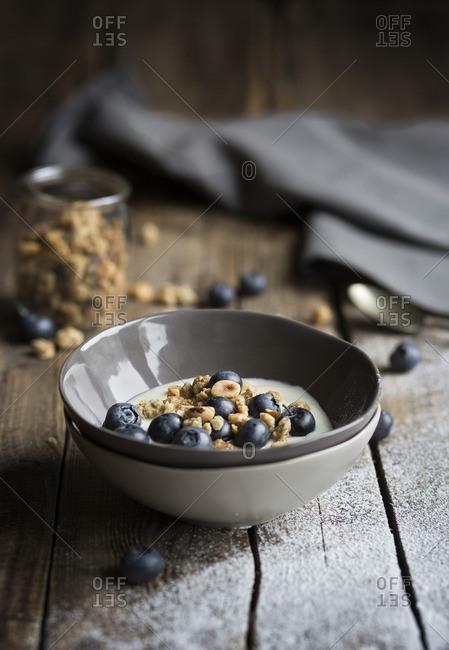 Bowl of yogurt with blueberries and muesli