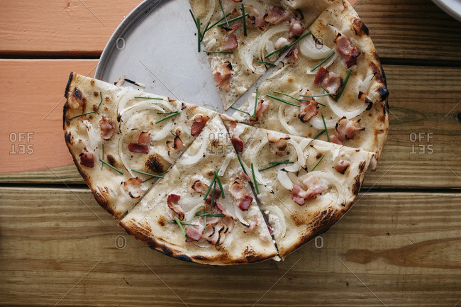 Bacon and onion pizza slices