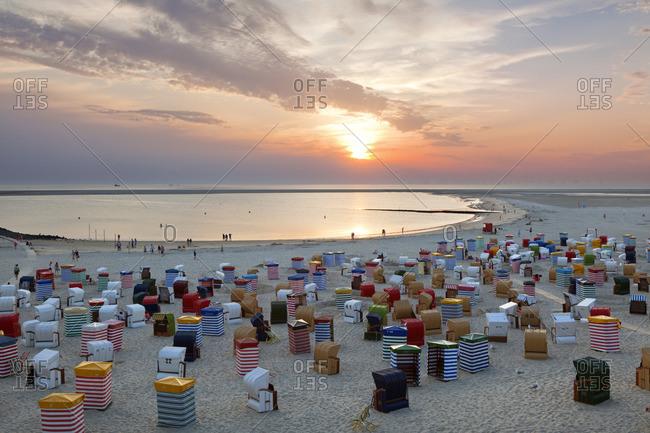 Borkum, Germany - July 19, 2014: People on the beach watching the sunset, Borkum, Ostfriesland, Lower Saxony, Germany