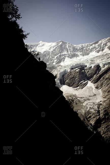 Hiker on mountain trail, on the way to Schreckhorn hut, Lower Grindelwald glacier, Bernese Oberland, Switzerland