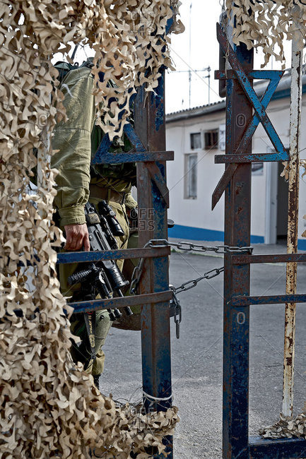 Israel - November 18, 2016: Soldier behind a chained door, Border from Israel to Lebanon, Israel