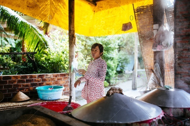 Can Tho, Vietnam - October 3, 2016: A woman at a small noodle-making house in the Mekong Delta in southern Vietnam
