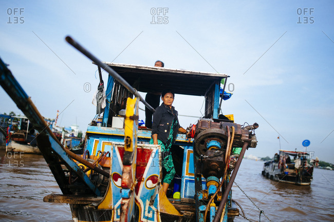 Chau Doc, Vietnam - October 2, 2016: Woman on a boat in the floating market in Chau Doc in the Mekong Delta, in southern Vietnam