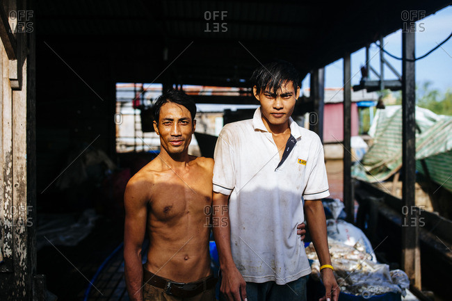 Chau Doc, Vietnam - October 2, 2016: A portrait of two fishermen in the Mekong Delta, southern Vietnam