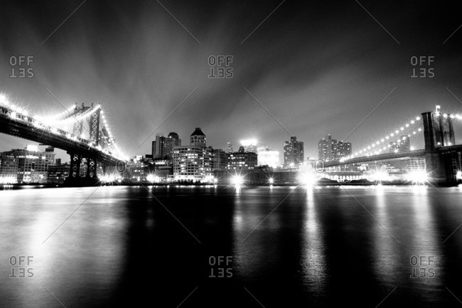 Brooklyn and Manhattan Bridges on the East River at night, New York City, New York, USA
