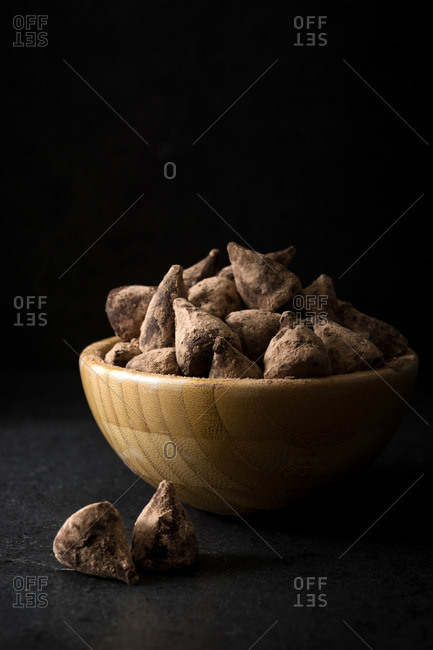 Chocolate truffles in a wooden bowl