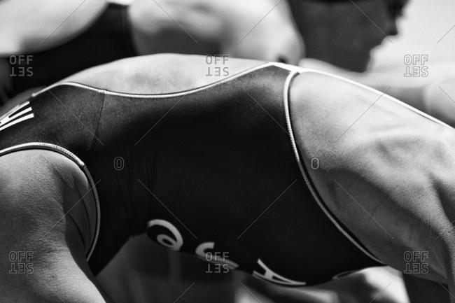 Close-up of triathletes preparing for a swim start