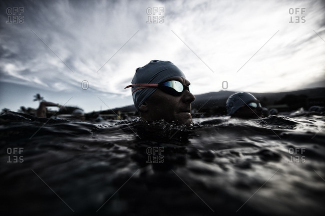 Hawaii - October 8, 2016: Swimming triathletes in open water
