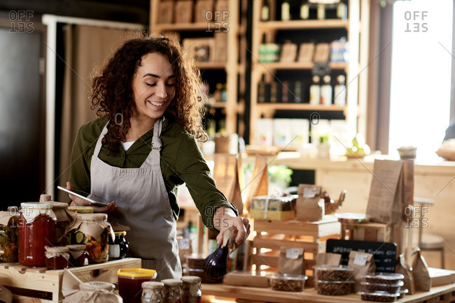 Portrait of attractive female entrepreneur working in her homemade products store