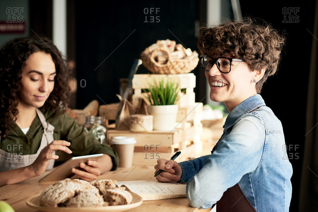 Young businesswoman in glasses and apron running a small eco products shop