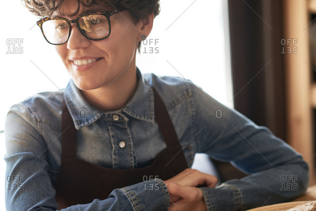 Extreme close-up portrait of successful businesswoman in apron running a small bakery