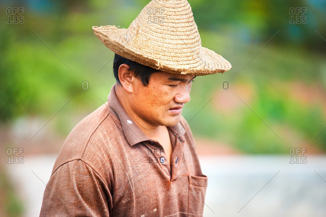 Menglian, Yunnan, China - March 3, 2016: Portrait of Chinese coffee farmer