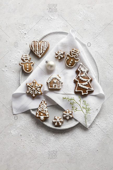 German spiced Christmas cookies on a plate sprinkled with powdered sugar