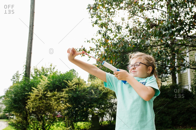 Little girl flinging a finger rocket