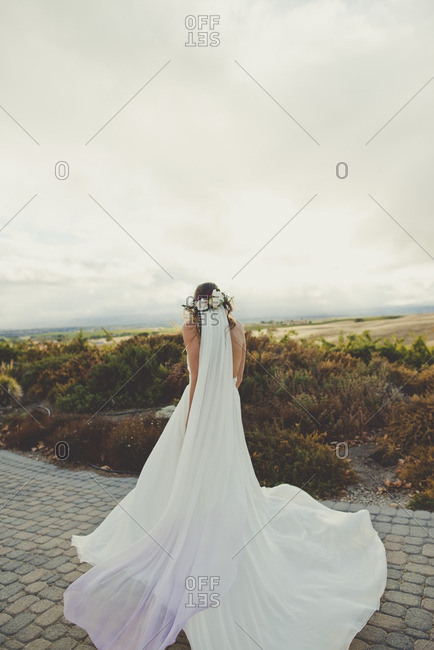 Bride wearing long veil and white gown with train