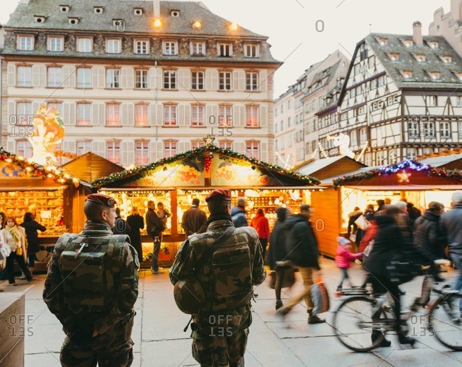 Strasbourg, France - December 6, 2015: Anti-terrorist armed forces surveilling the security in the Christmas market in Place Gutenberg