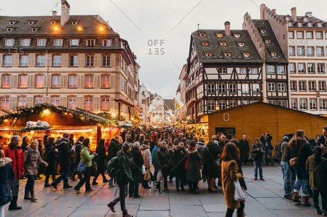 Strasbourg, France - December 6, 2015: View of the iconic rue Merciere and the crowd coming to the Christmas market in front of the Notre-Dame Cathedral