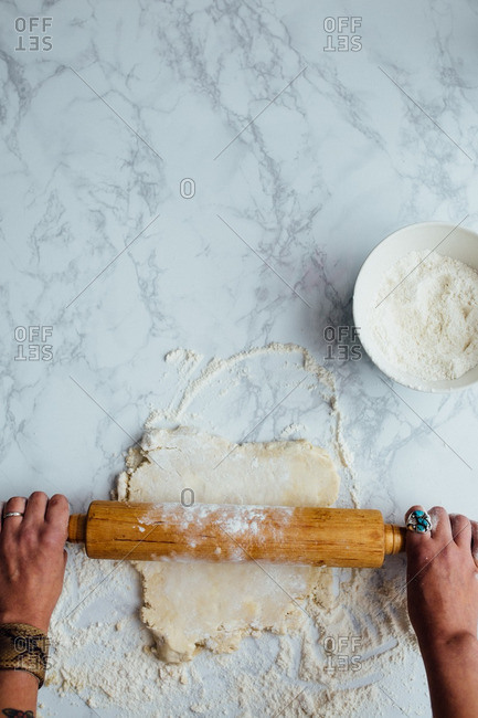 Hand rolling out pie crust dough