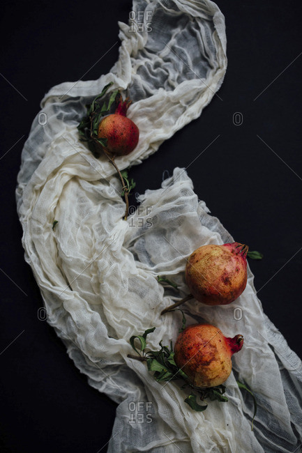 Pomegranate fruit on cheesecloth