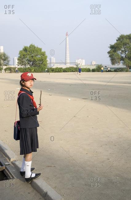 Pyongyang, North Korea - May 4, 2007: Girl waiting at school football field in Pyongyang in North Korea
