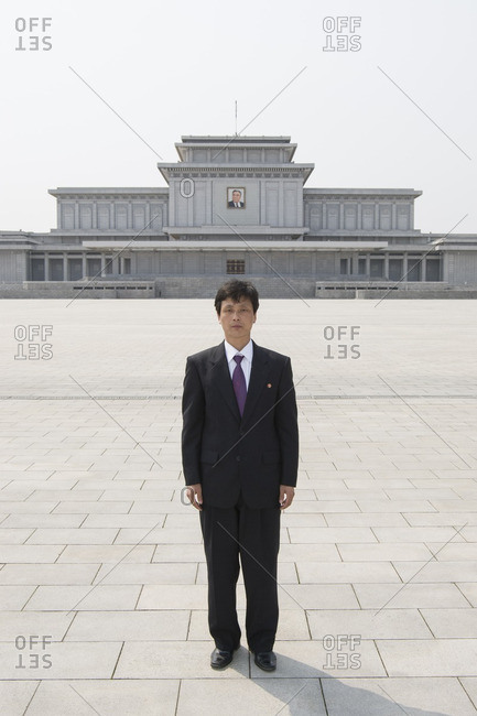 Pyongyang, North Korea - April 29, 2007: Guide in front of the Kumsusan Palace of the Sun, it is the Kim Il-sung Mausoleum
