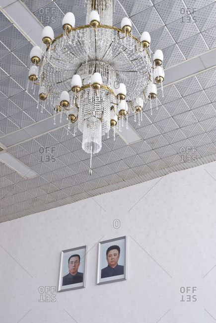Pyongyang, North Korea - May 5, 2007: Pyongyang airport lobby with portraits of Kim Il Sung and Kim Jong Il