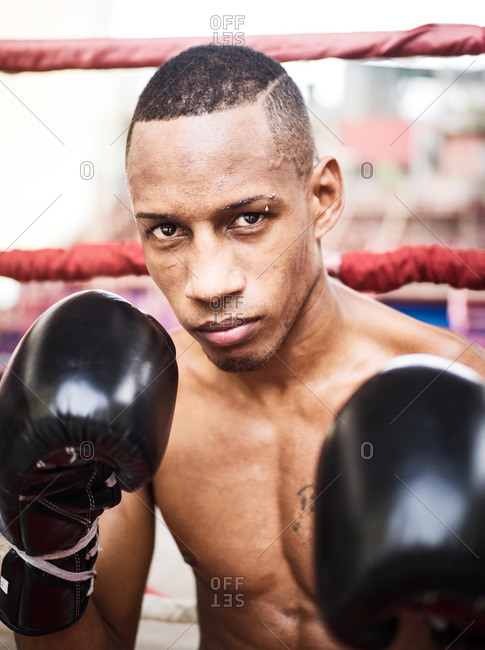 Havana, Cuba,  - September 1, 2016: Male boxer holding up fists with boxing gloves