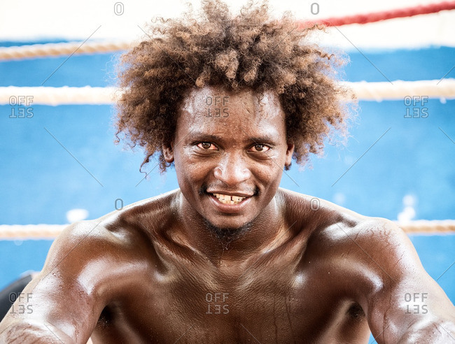 Havana, Cuba,  - September 1, 2016: Male boxer sitting by ring and dripping with sweat