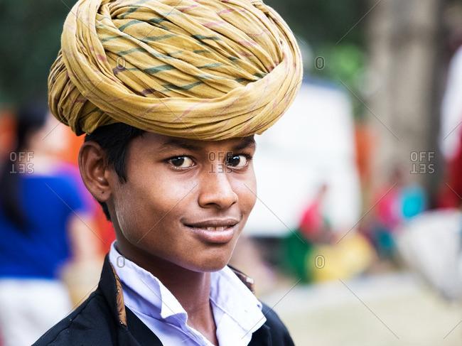 Delhi, India - November 5, 2015: Young Indian boy wearing a turban
