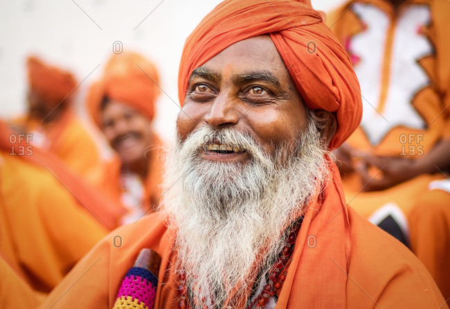 Delhi, India - November 5, 2015: Indian man in orange traditional clothing