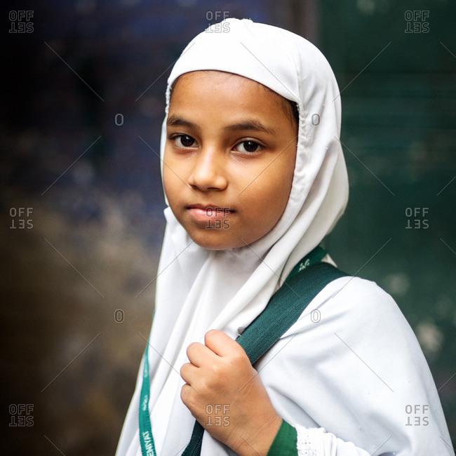 Delhi, India - November 9, 2015: Young girl wearing white headdress