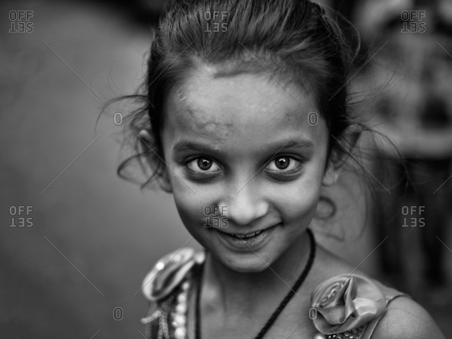 Jaipur, India - November 10, 2015: Close up of a happy Indian girl in black and white