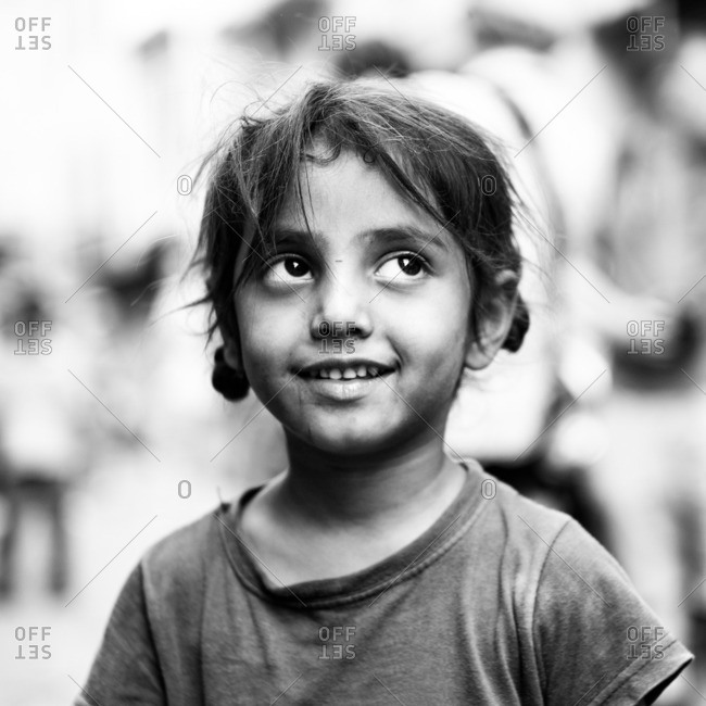 Jaipur, India - November 10, 2015: Close up of a little Indian girl in black and white