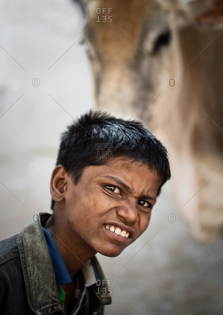 Jaipur, India - November 11, 2015: Young Indian boy with a twisted facial expression