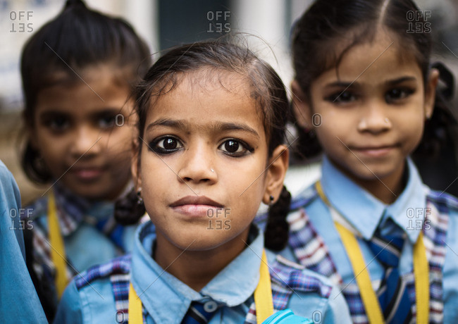 Varanasi, India - November 16, 2015: Three young Indian girls in school uniforms