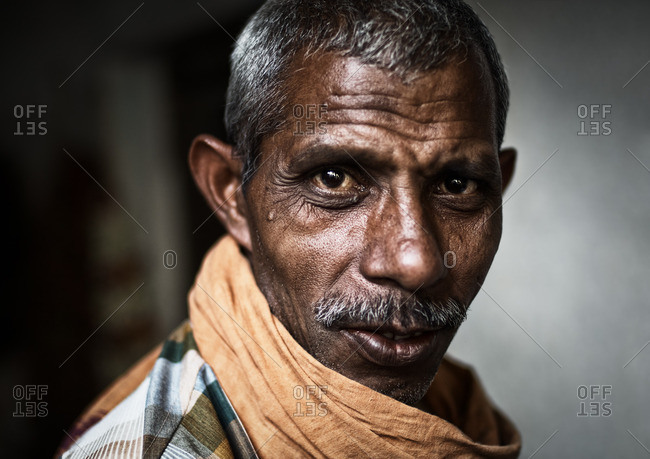 Varanasi, India - November 16, 2015: Portrait of an Indian man wearing a scarf